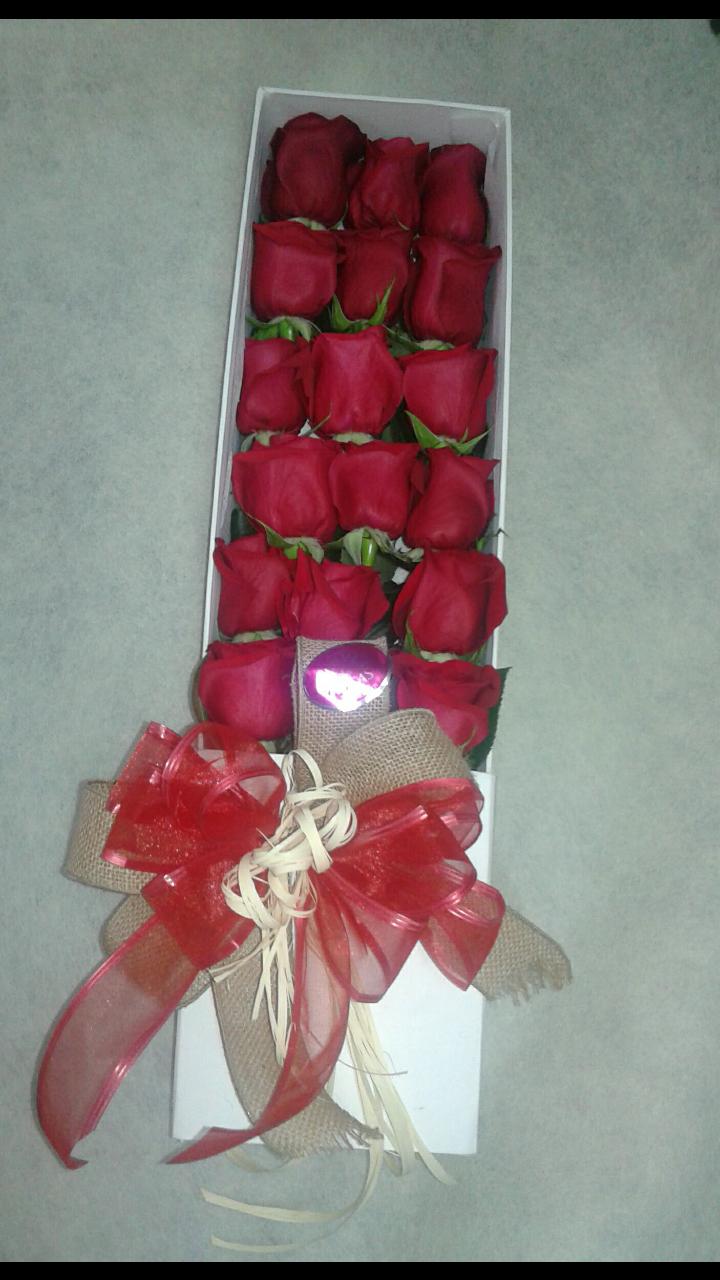 Caja de Rosas rojas .
